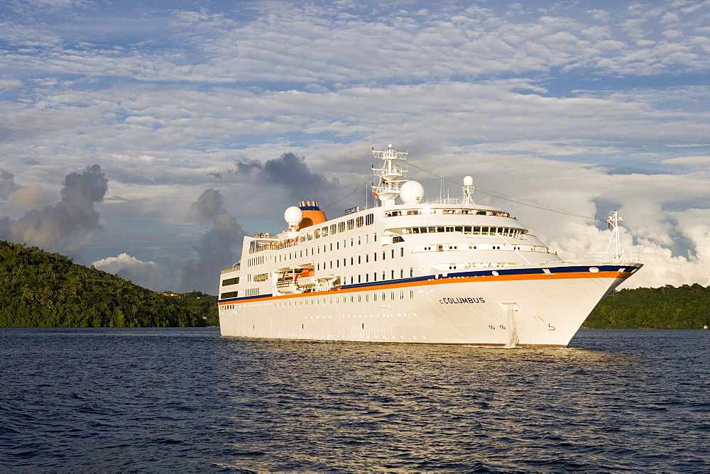 Cruiseship MV Columbus raising anchor in the light of the evening sun, Vava'u archipelago, Tonga, South Pacific, Oceania