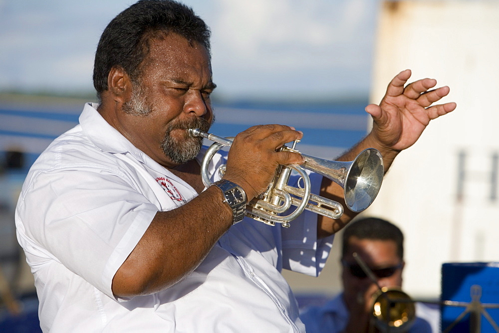 Tongan Brass Band Leader playing the trumpet on MV Columbus, Nuku'alofa, Tongatapu, Tonga, South Pacific, Oceania