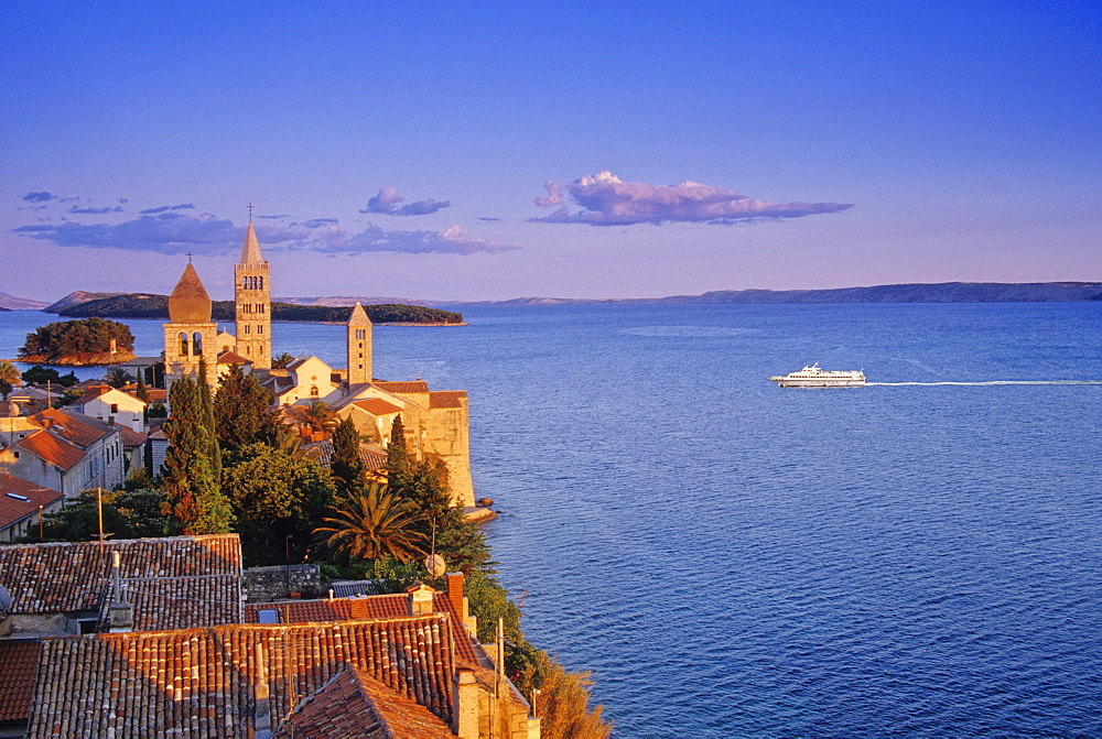 View over Bay of Kvarner to the steeples of Rab in the light of the evening sun, Rab island, Croatian Adriatic Sea, Dalmatia, Croatia, Europe