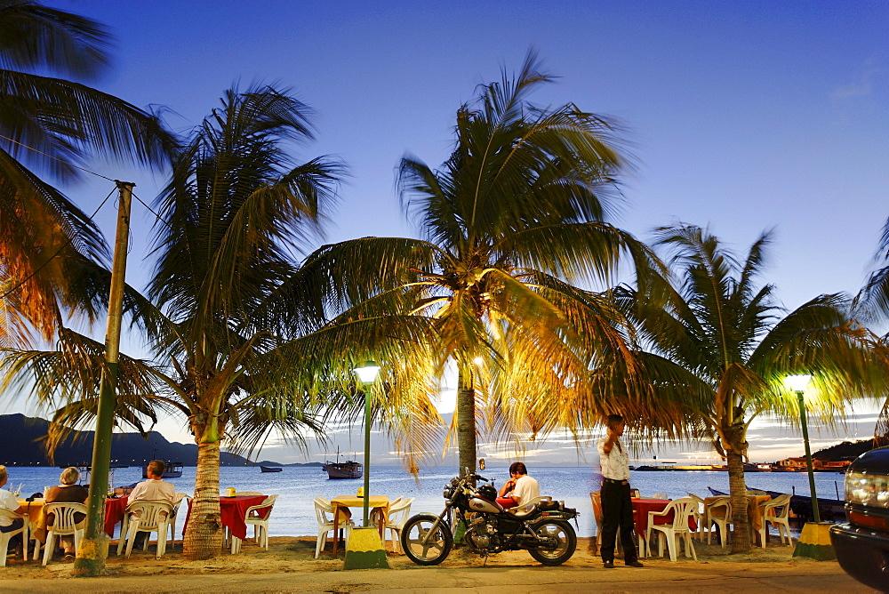 Beach bar at promenade in the evening, Juangriego, Isla Margarita, Nueva Esparta, Venezuela