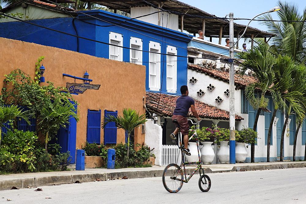 Man riding a curious bicycle, Playa El Tirano, Isla de Margarita, Nueva Esparta, Venezuela