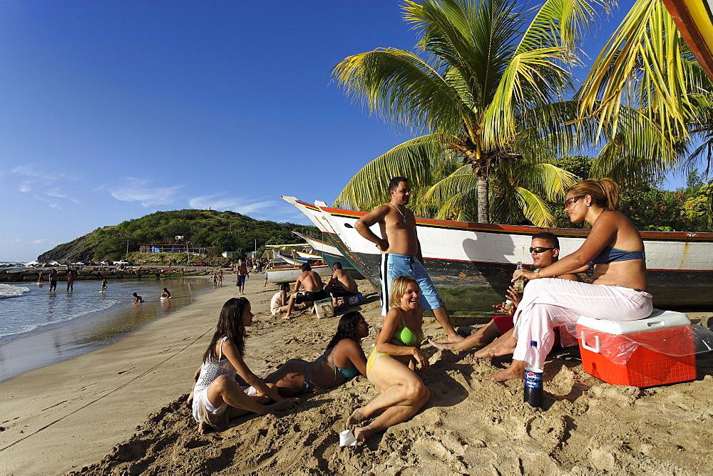 People sunbathing at Playa Zaragoza, Pedro Gonzales, Isla Margarita, Nueva Esparta, Venezuela
