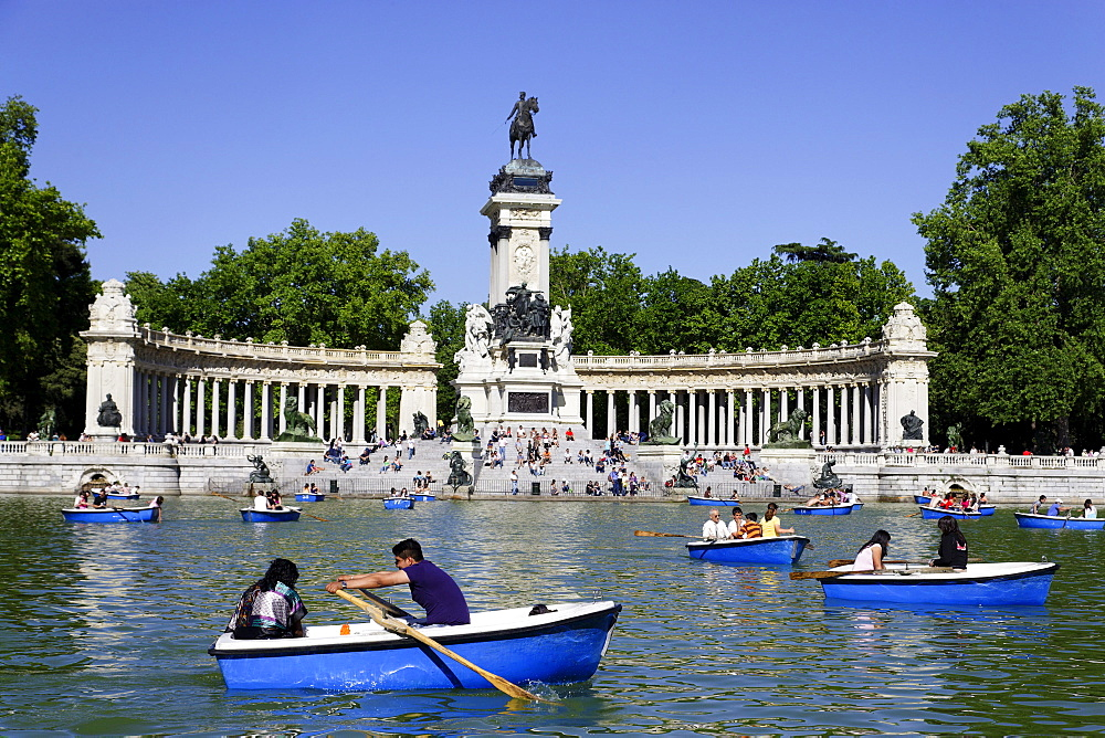 People relaxing near Monument to Alfonso XII, Parque del Buen Retiro, Madrid, Spain