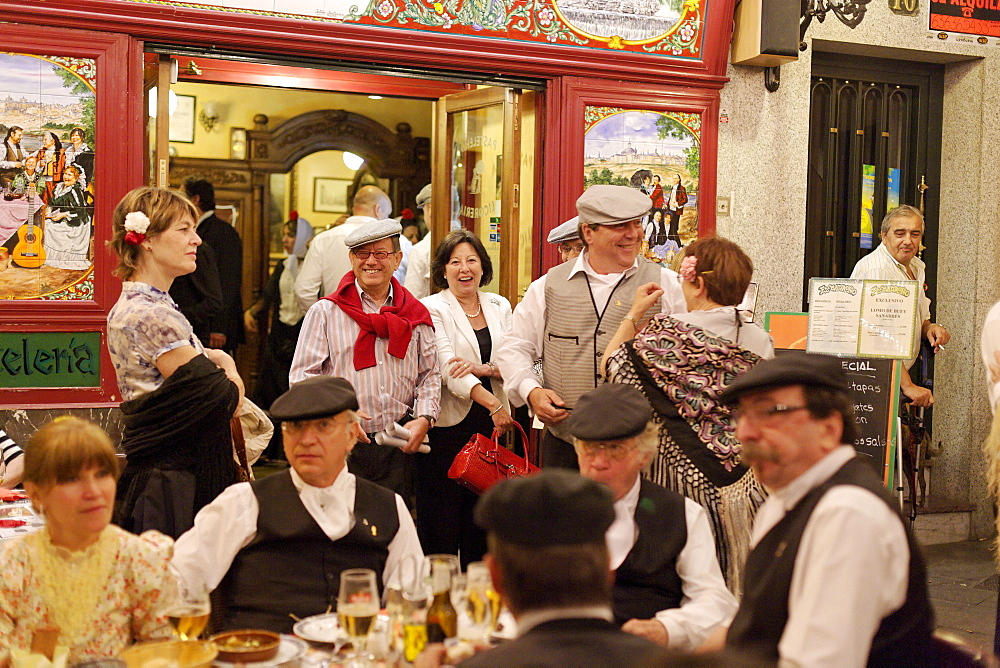 Couples dancing in front of Madrono restaurant, Fiestas de San Isidro Labrador, Madrid, Spain