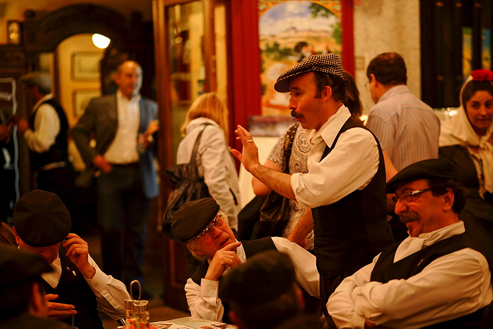 Group of men in a pavement cafe, Fiestas de San Isidro Labrador, Madrid, Spain