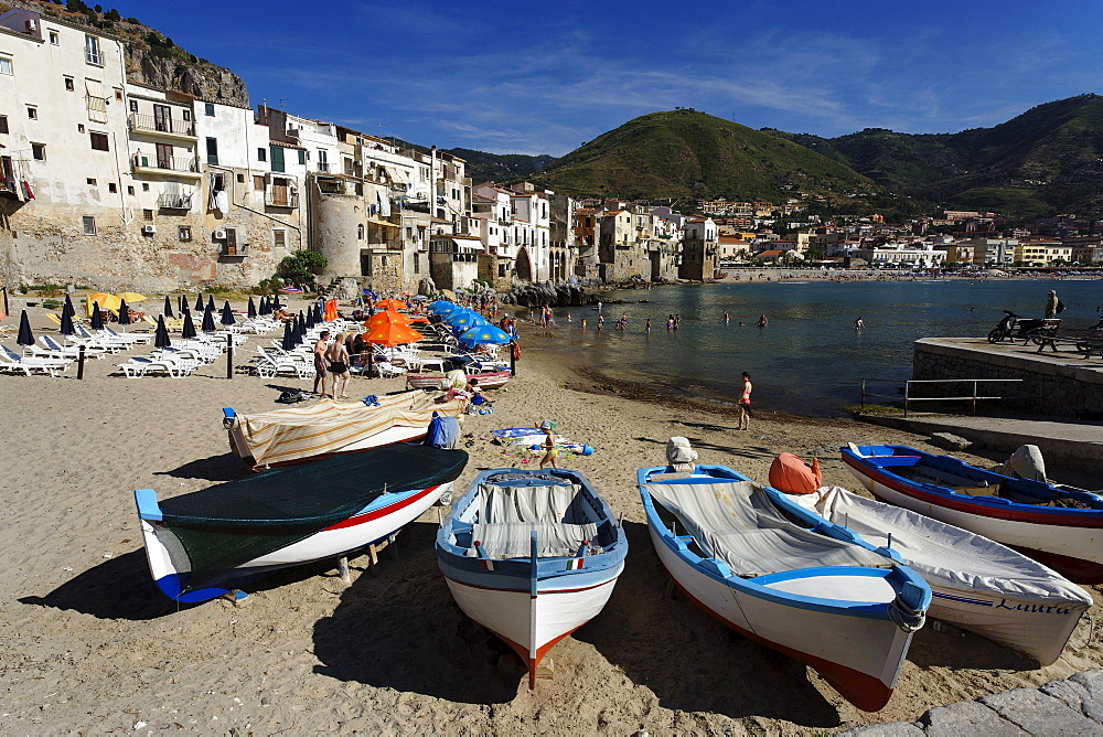 View along beach of Cefalu, Sicily, Italy