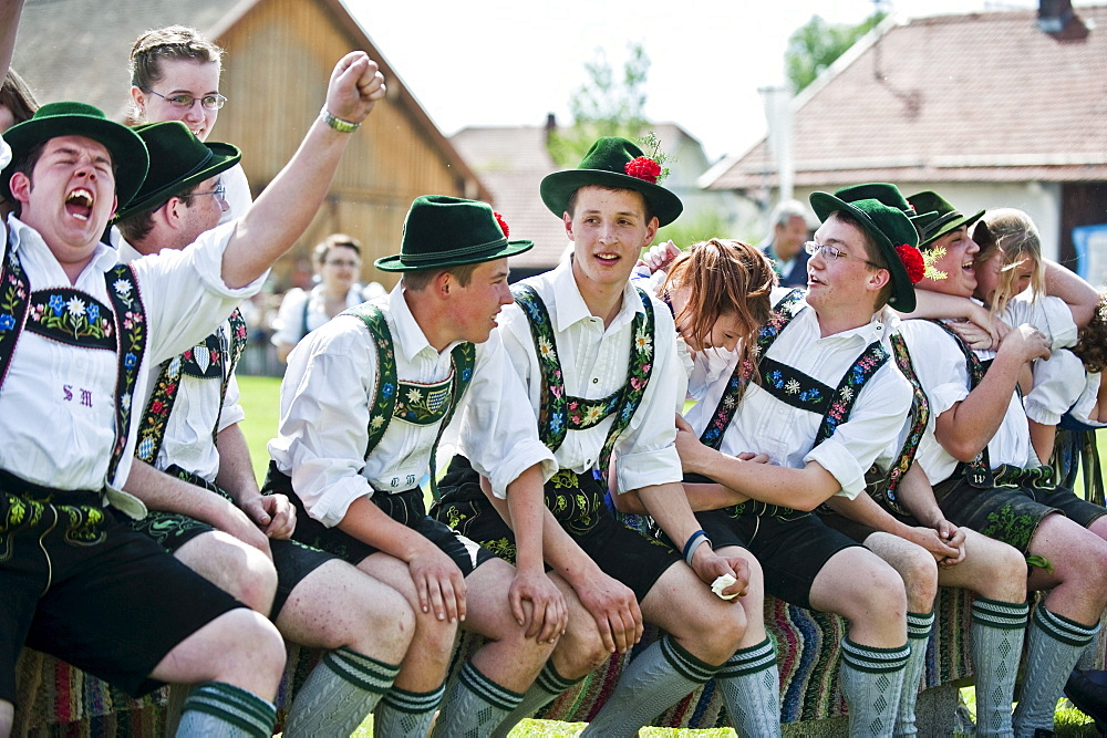 Young people wearing traditional costumes, May Running, Antdorf, Upper Bavaria, Germany
