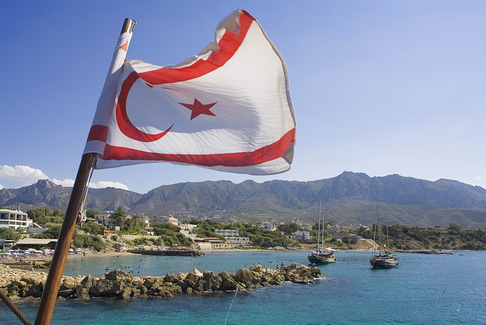 Neptun Pirate boat trip, by Kaleidoskop Turizm, and coast, with flag of the Turkish Republic of Northern Cyprus, Kyrenia, Girne, Cyprus