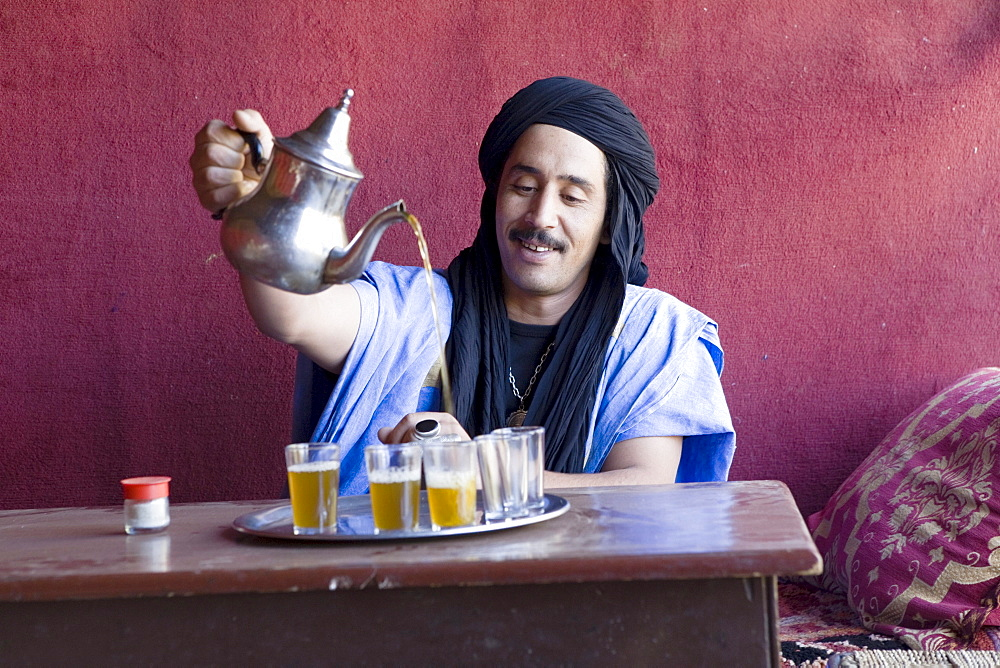 Berber performing the traditional tea ceremony in Marrakech, Morocco