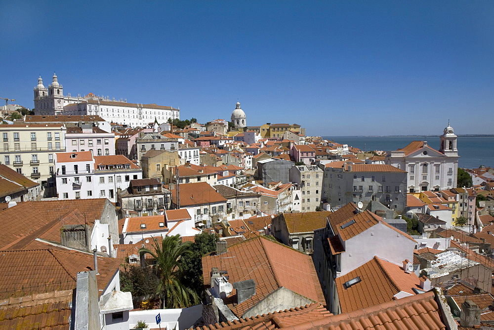 View from Miradouro Santa Luzia, Viewpoint towards the Alfama quarter with the Santa Engr·cia church and the Tejo River, Portugal, Lisbon