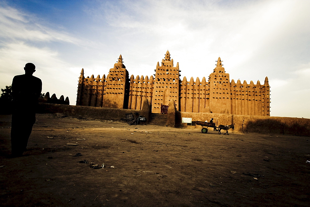 Mosque of Djenna under clouded sky, Mali, Africa