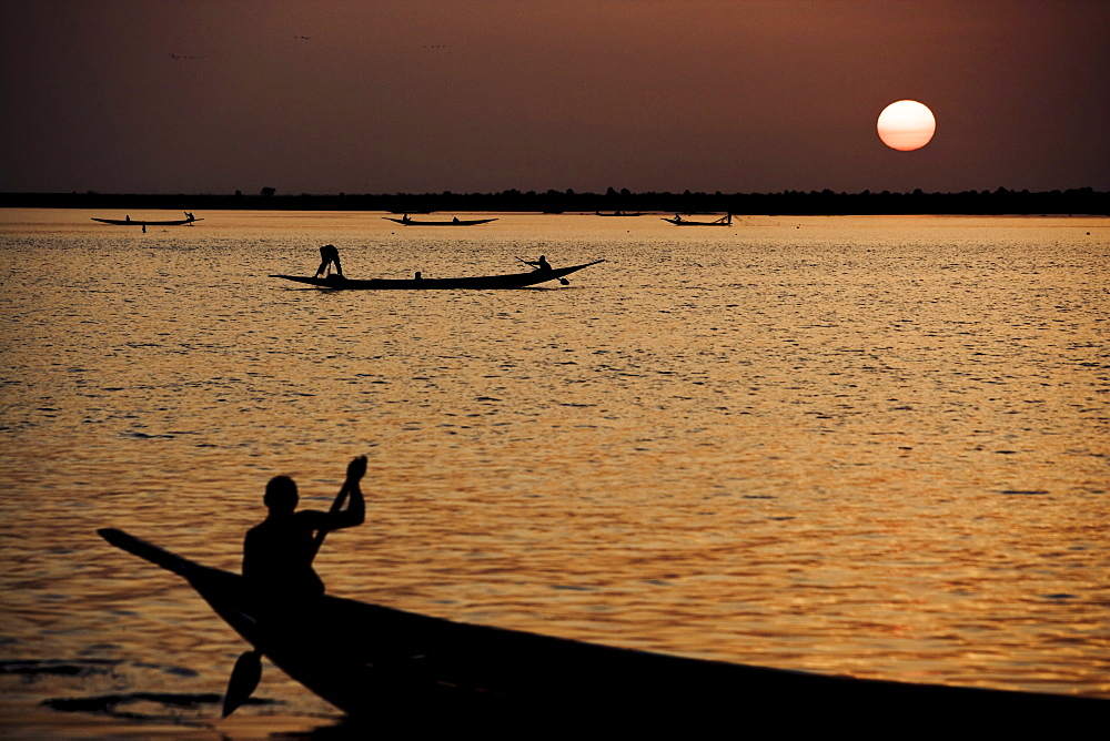 People in boats on the river Niger at sunset, Mopti, Mali, Africa