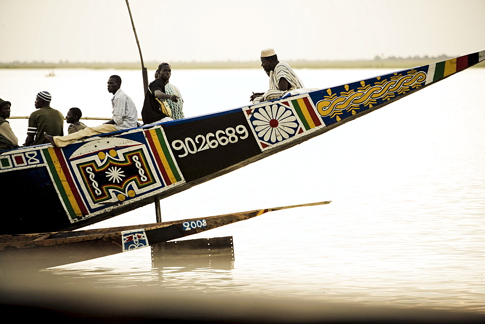 People in a painted boat on the river Niger, Mopti, Mali, Africa