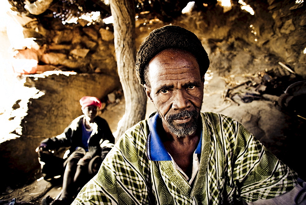 African blacksmith and a helper in a hut, Sangha, La Falaise de Bandiagara, Mali, Africa