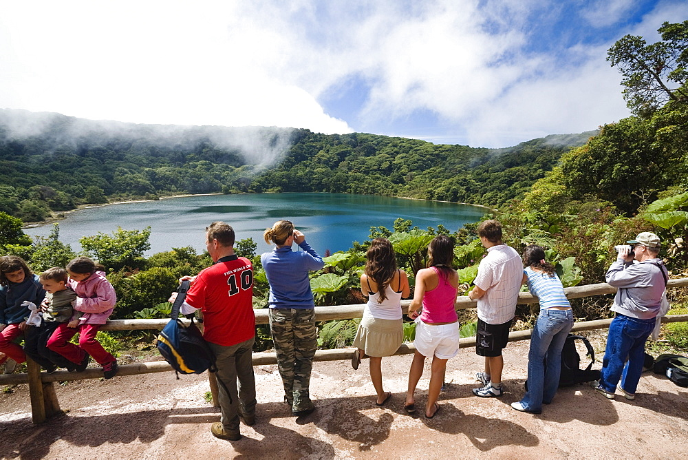 Tourists at crater lake, Laguna Botos, Poas National Park, Costa Rica, Central America