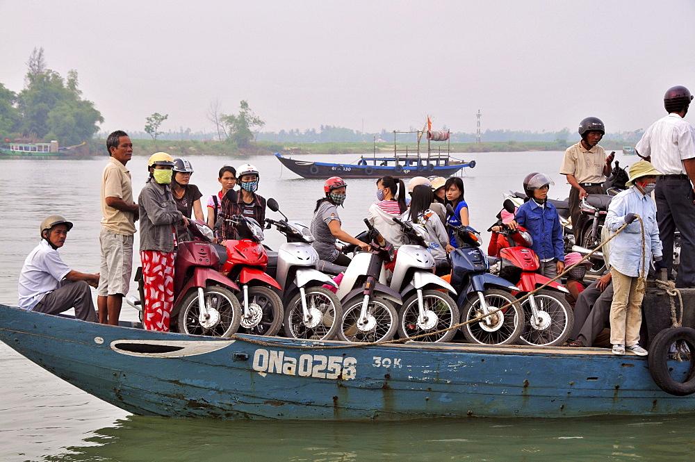 Ferry boat with mopeds on the Thu Bon river in Hoi An near Da Nang, Vietnam
