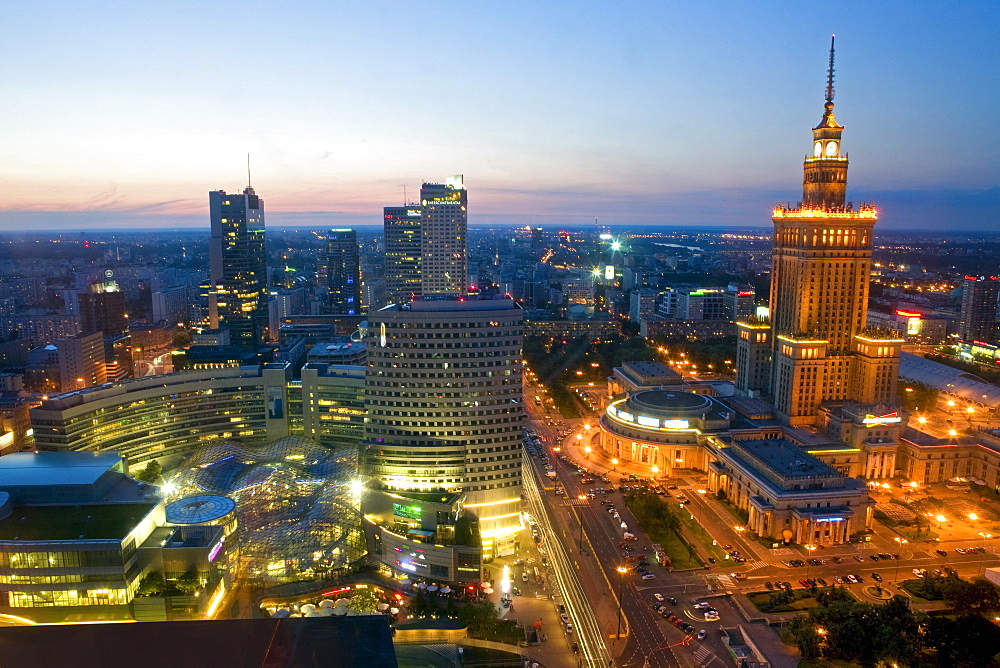 The Zlote Tarasy Shopping Complex and the Palace of Culture and Sciences in the evening, Warsaw, Poland, Europe