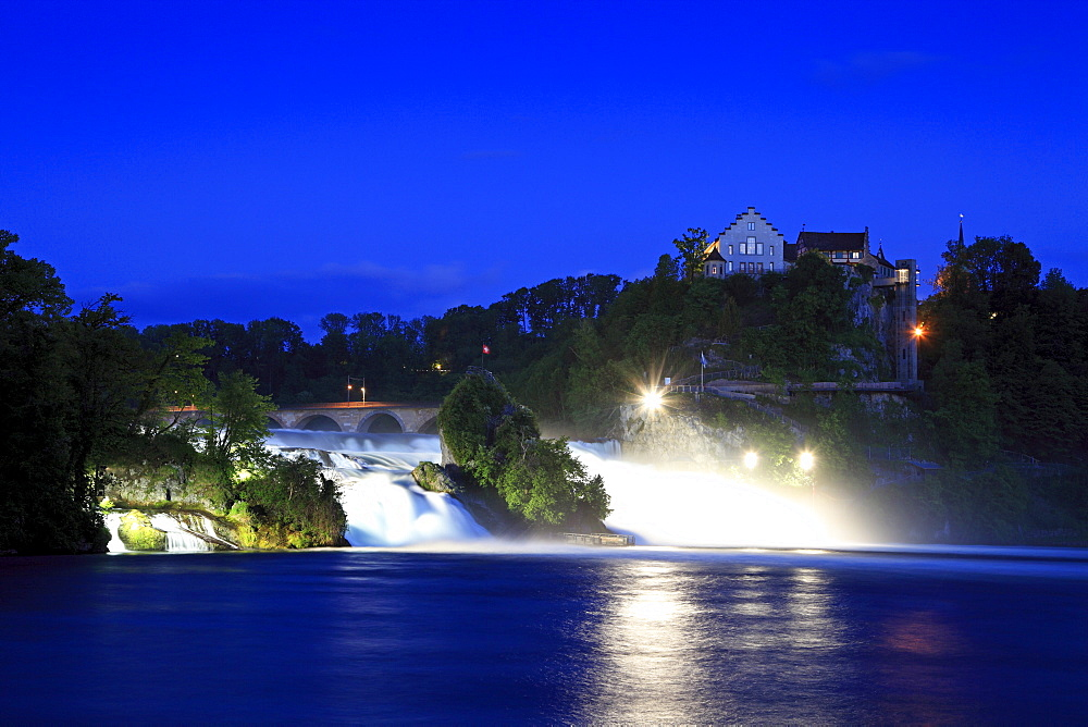 The illuminated Rhine Falls near Schaffhausen in the evening, Laufen castle, High Rhine, Canton Schaffhausen, Switzerland, Europe