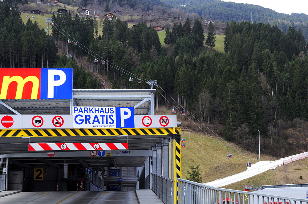 Parking deck and skiing area with artificial snow in the background, Zillertal skiing area, Zillertal valley, Tyrol, Austria
