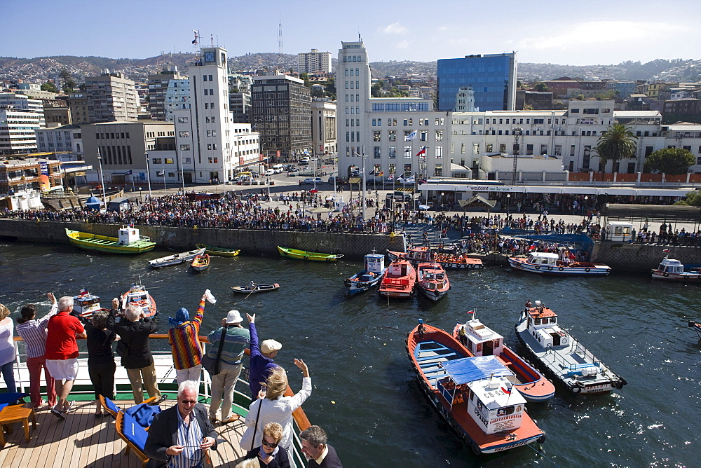 People on deck of cruiseship MS Deutschland (Deilmann Cruises) and view at city as vessel departs, Valparaiso, Chile, South America, America