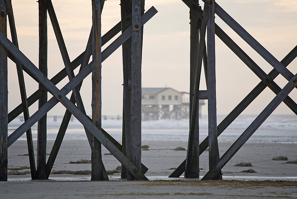 Buildings on stilts on the beach at St Peter-Ording, Schleswig-Holstein, North Sea coast, Germany