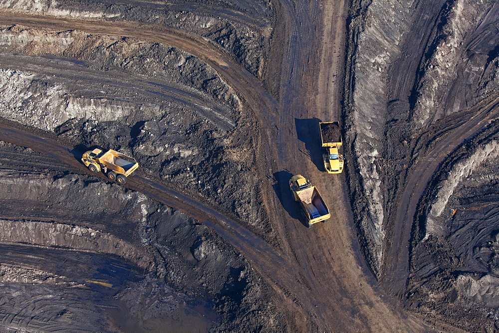 Aerial view of an open-pit lignite mine, Lorries transporting brown coal, Schoeningen, Lower Saxony, Germany - 1113-35664