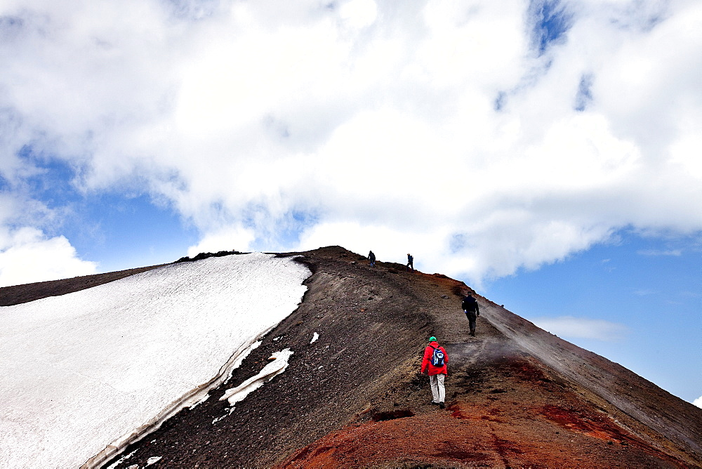 Hikers mounitng Etna, Sicily, Italy