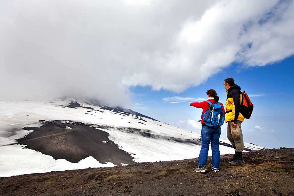 Two hikers at Mount Etna, Sicily, Italy