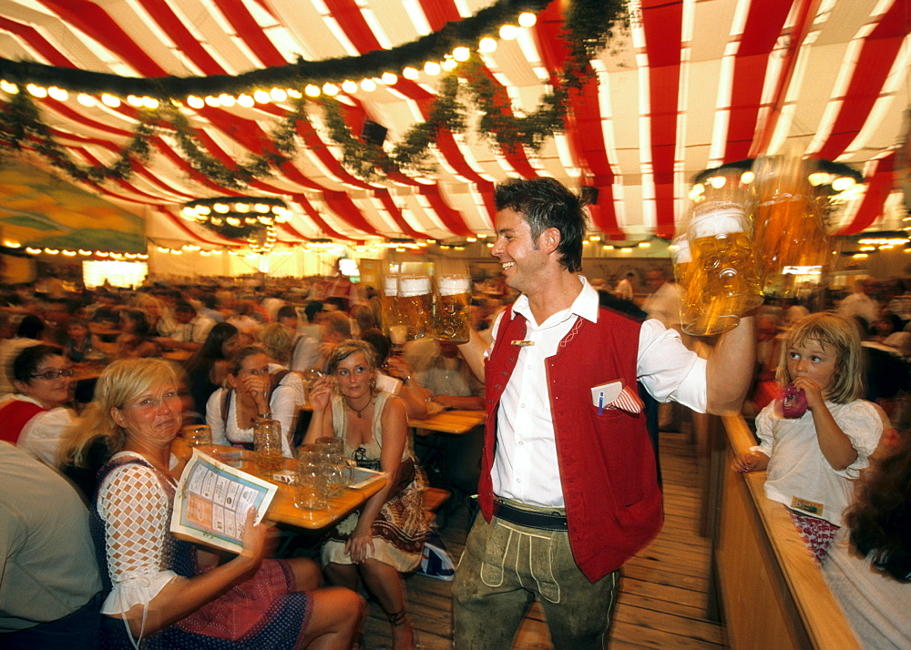Waiter carrying large beer steins, Gauboden Festival, Straubing, Lower Bavaria, Germany