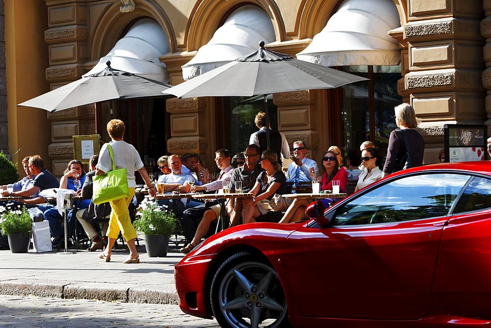 People sitting outside Cafe Kaemp, Esplanadi in summer, Helsinki, Finland