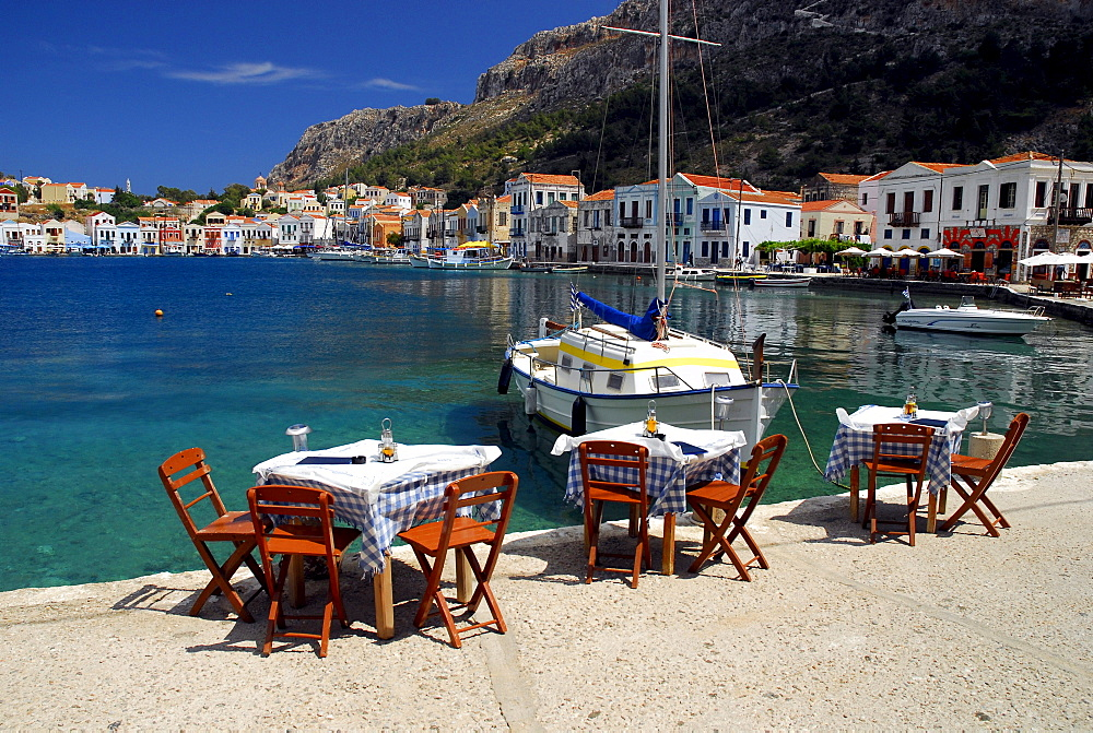 Restaurant terrace on the waterside, Megisti town on the Kastelorizo Island, Meis, Dodecanese Islands, Aegean, Mediterranean, Greece
