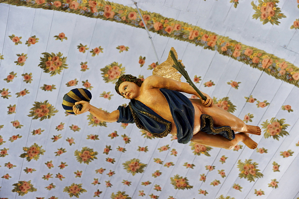 Pending angel inside the church at Kloster, Hiddensee, Mecklenburg-Western Pomerania, Germany, Europe