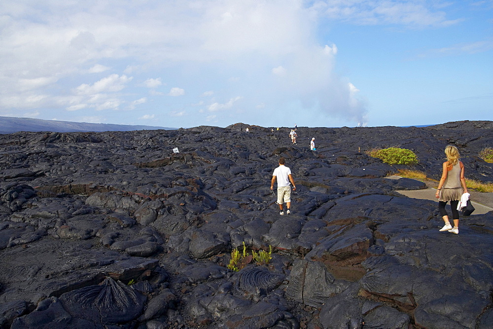 People walking over volcanic rocks, Hawaii Volcanoes National Park, Chain of Craters Road, Big Island, Hawaii, USA, America