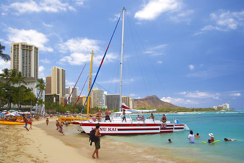 People, boat and catamaran at Waikiki Beach, Honolulu, Oahu, Island, Hawaii, USA, America