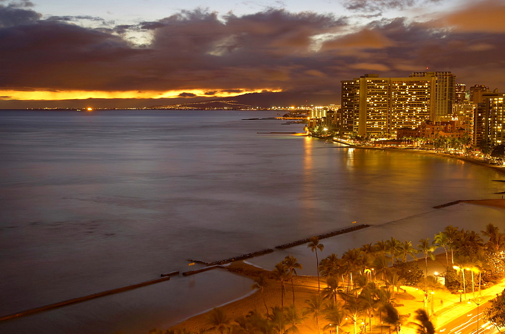 View at illuminated hotels at the beach in the evening, Waikiki Beach, Honolulu, Oahu, Hawaii, Island, USA, America