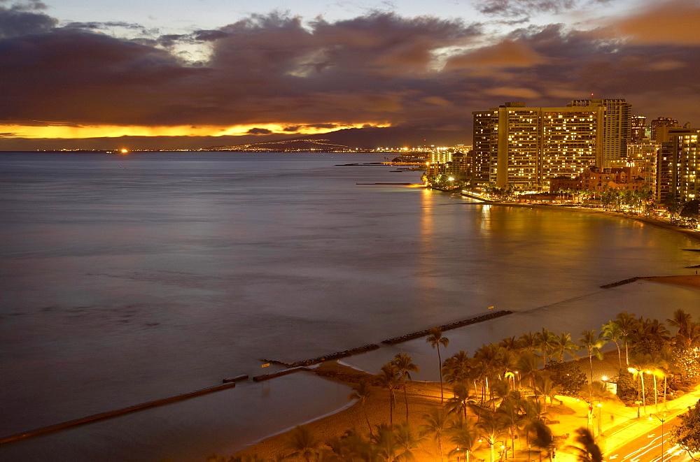View at illuminated hotels at the beach in the evening, Waikiki Beach, Honolulu, Oahu, Hawaii, Island, USA, America