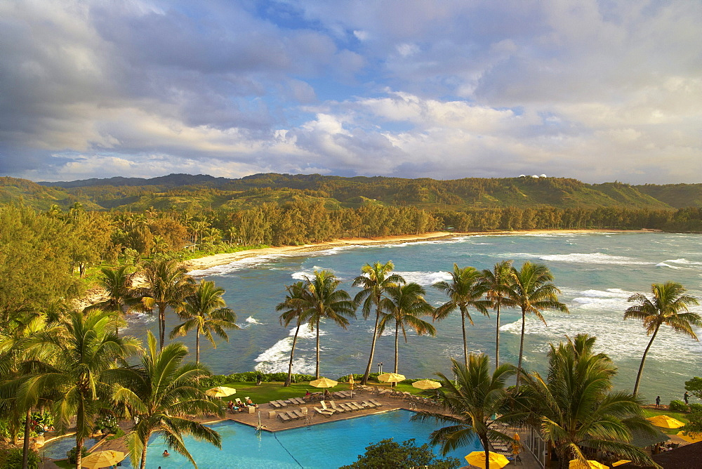 Pool under palm trees at the coast in the evening, North Shore, Turtle Bay, Oahu, Hawaii, USA, America