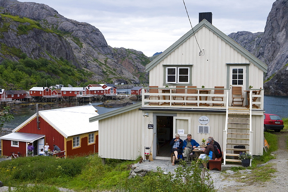 People enjoy Afternoon Coffee outside Bakery, Nusfjord, Flakstadoy, Lofoten, Nordland, Norway, Europe