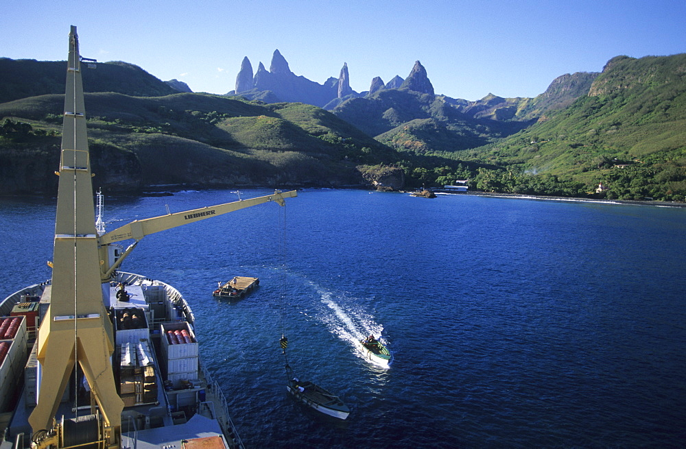The freighter Aranui III anchoring off the island of Ua Pou, French Polynesia