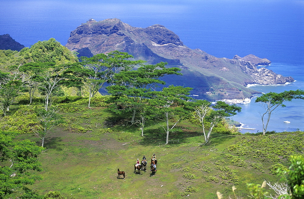 Horese riders near Muake Saddle on the island of Nuku Hiva, French Polynesia