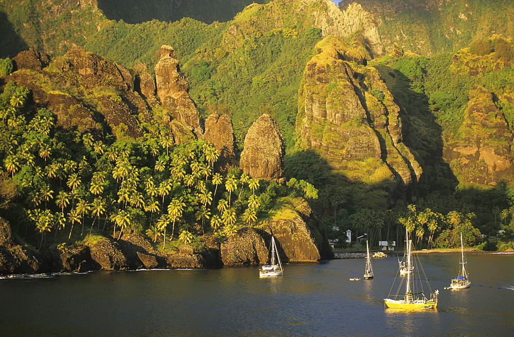 Sailing boats in the Bay of Hanavave on the island of Fatu Iva, French Polynesia
