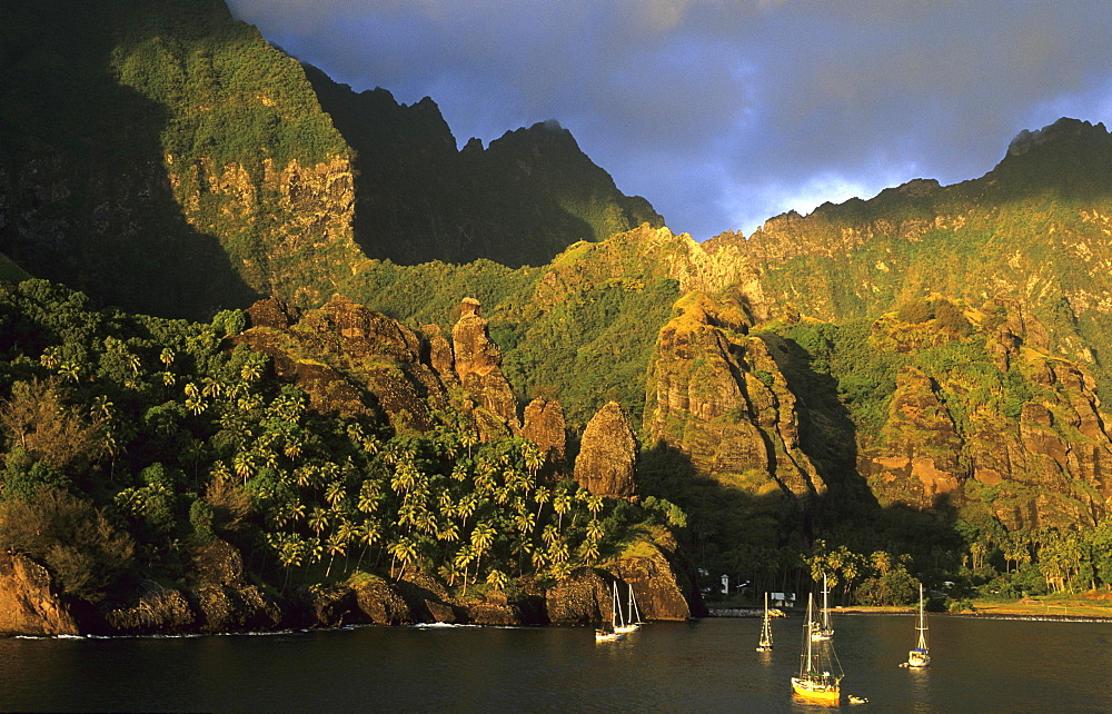 Boats anchoring in the Bay of Hanavave on the island of Fatu Iva, French Polynesia