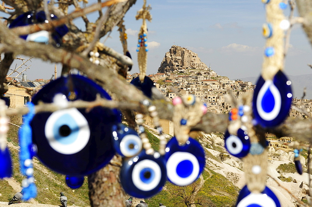 Protection amulets against evil eye in front of the mountain city Uchisar, Goereme, Cappadocia, Turkey