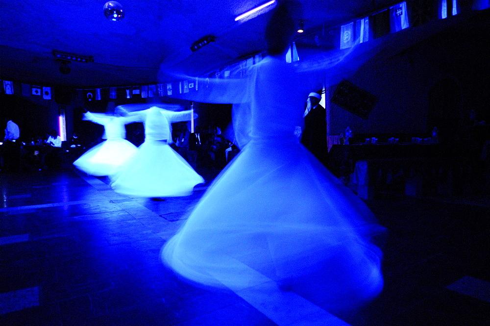 Dervish dancing at the folklore evening in Yasar Baba restaurant, Goereme, Cappadocia, Turkey