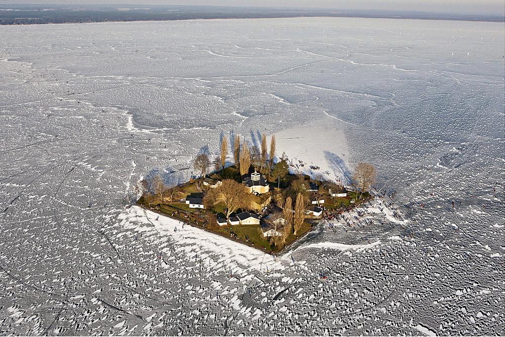 Aerial of people on the frozen Lake Steinhude in winter, Wilhelmstein island, Hannover region, Lower Saxony, Germany