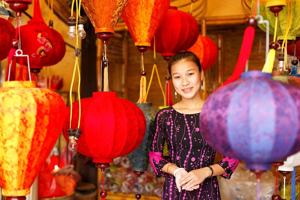 Woman inside a lampion store, Hoi An, Annma, Vietnam