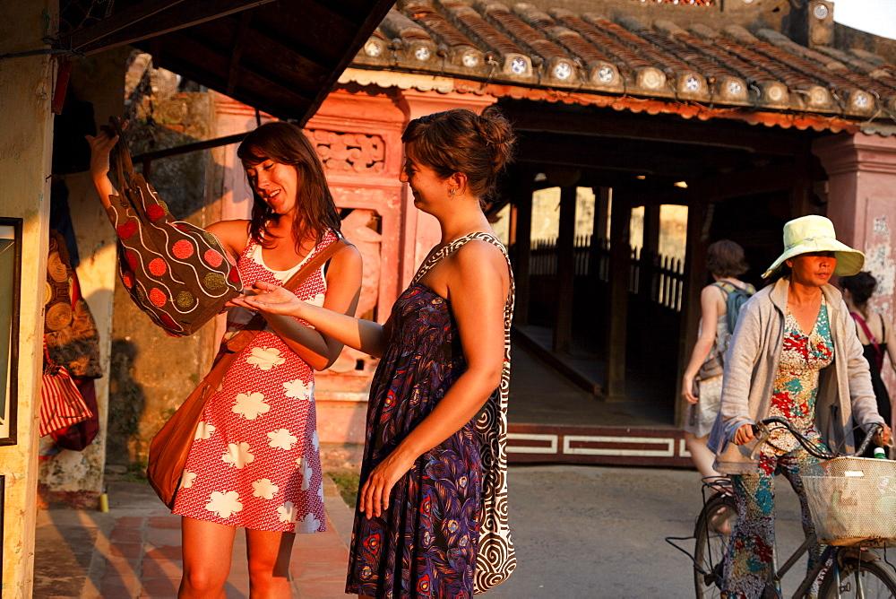 Two women shopping, Chua Cau, Japanese Bridge, Hoi An, Annam, Vietnam