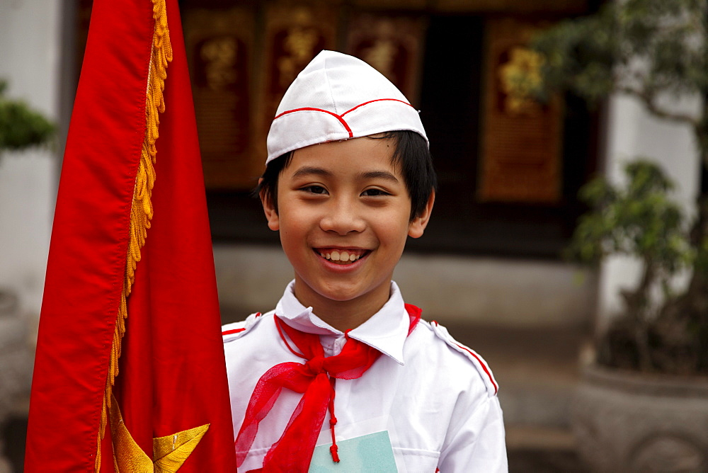 Pupil holding a flag, Temple of Literature (Van Mieu), Hanoi, Bac Bo, Vietnam
