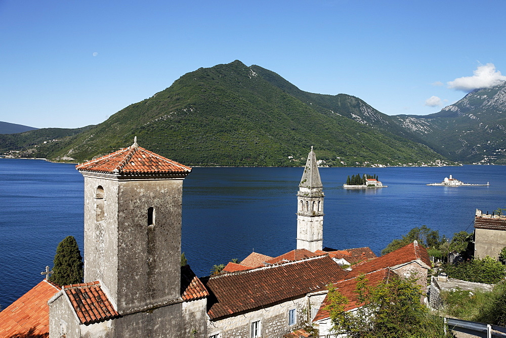 View of Sveti Nikola church with bell tower, in the background Gospa od Skrpjela island and Sveti Dorde island, Perast, Bay of Kotor, Montenegro, Europe