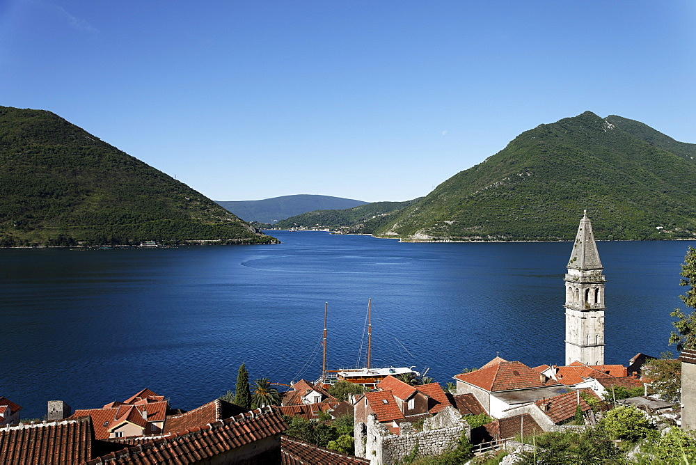 View of Sveti Nikola church with bell tower, Perast, Bay of Kotor, Montenegro, Europe